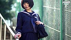 Short Haired Minori Pausing Wearing Kogal Uniform Hand Resting On Railing
