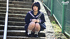 Short Haired Kogal Seated On Steps Hands In Fists Upskirt Panties
