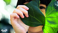 Playing With Broad Green Leaves