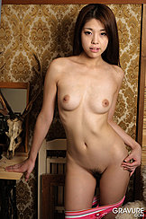 Standing Naked Beside Desk Small Breasts Trimmed Pussy Hand On Hip Panties Around Her Thighs