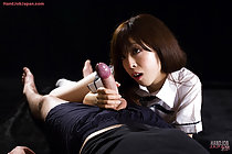 Kogal lying on her side with big cock in her hand looking at it intently