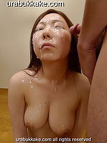 Face drenched with bukkake cumshots cum dripping down her neck and over her breasts