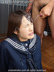 Kogal Seated In Front Of Masturbating Man Shooting Cum Over Her Face