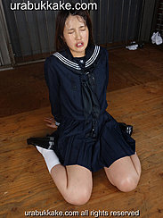 Kogal Natsumi Seated On Floor Wearing Seifuku Uniform Face Covered In Bukkake Cumshots